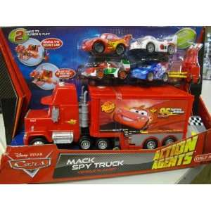 Disney Pixar Cars Mack Spy Truck Vehicle Playset with 4 Small Cars and